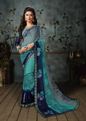 Grab This Beautiful Saree For The Summers. This Saree And Blouse are Georgette Based Beautified With Prints All Over. This Weightless Fabric Is Easy To carry All Day Long.