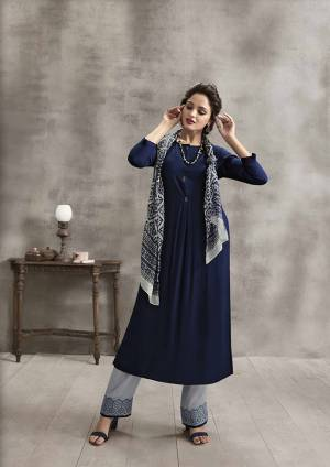 Enhance Your Personality In This Rich Color Pallete With This Designer Readymade Kurti Set In Navy Blue Color paired With Grey Colored Plazzo And Scarf. Its Top And Bottom are Rayon Fabricated Paired With Soft Cotton Scarf. It Has Pretty Thread Work Over Plazzo And Printed Scarf.