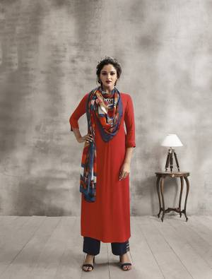 Celebrate This Festive Season Wearing Designer Readymade Plazzo Set In Orange Colored Kurti Paired With Contrasting Navy Blue Colored Plazzo And Multi Colored Scarf. Its Top And Bottom Are Rayon Based Paired With Soft Cotton Scarf. Buy Now.