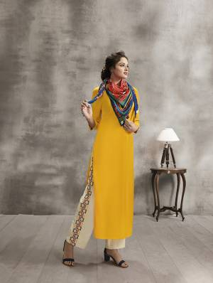 Grab This Rich Looking Designer Readymade Kurti In Yellow Color Paired With Cream Colored Bottom And Multi Colored Scarf. Kurti And Plazzo are Fabricated On Rayon Paired With Soft Cotton Printed Dupatta. All Its Fabrics are Soft Towards Skin And Easy To Carry All Day Long.