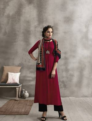 Shine Bright Wearing This Designer Readymade Kurti In Maroon Color Paired With Contrasting Blue Colored Plazzo And Multi Colored Scarf. Its Top And Bottom are Rayon Based Paired With Soft Cotton Fabricated Printed Scarf. Buy Now.