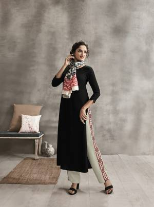 Enhance Your Personality In This Rich Color Pallete With This Designer Readymade Kurti Set In Black Color paired With Off-White Colored Plazzo And Multi Colored Scarf. Its Top And Bottom are Rayon Fabricated Paired With Soft Cotton Scarf. It Has Pretty Thread Work Over Plazzo And Printed Scarf.