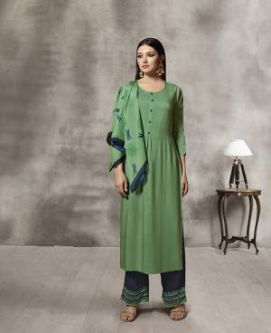 Celebrate This Festive Season Wearing Designer Readymade Plazzo Set In Green Colored Kurti Paired With Contrasting Navy Blue Colored Plazzo And Green Colored Scarf. Its Top And Bottom Are Rayon Based Paired With Soft Cotton Scarf. Buy Now.