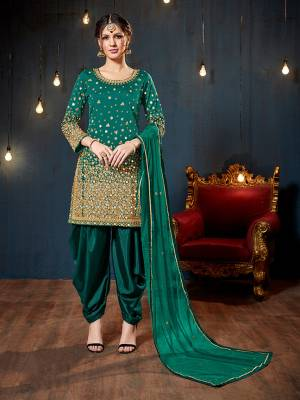 Get Ready For The Upcoming Festive And Wedding Season With This Heavy Designer Suit In Teal Green Color. Its Heavy Embroidered Top Is Fabricated On Tafeta Art Silk Paired With Santoon Bottom And Net Fabricated Dupatta. It Is Beautified With Heavy Jari Embroidery And Mirror Work.