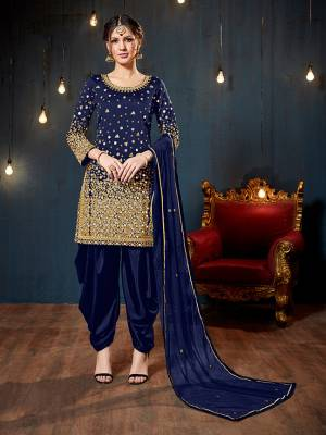 Get Ready For The Upcoming Festive And Wedding Season With This Heavy Designer Suit In Royal Blue Color. Its Heavy Embroidered Top Is Fabricated On Tafeta Art Silk Paired With Santoon Bottom And Net Fabricated Dupatta. It Is Beautified With Heavy Jari Embroidery And Mirror Work.