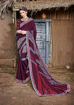 Grab This Beautiful Printed Saree For Semi-Casuals. This Saree And Blouse Are Fabricated On Magic Chiffon Beautified With Prints And Lace Border. It Is Light Weight And Easy To Carry All Day Long.
