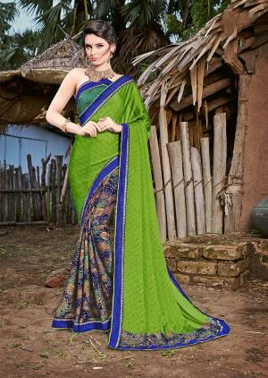 Here Is A Very Pretty For Your Casual Or Semi-Casual Wear. This Saree And Blouse Are Fabricated On Magic Chiffon Beautified With prints And Lace Border. Buy Now.