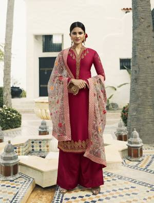 Shine Bright Wearing This Designer Straight Cut Suit In Dark Pink Color Paired With Baby Pink Colored Dupatta. Its Pretty Embroidered Top Is Fabricated On Satin Georgette Paired With Santoon Bottom And Embroidred Tissue Fabricated Dupatta.