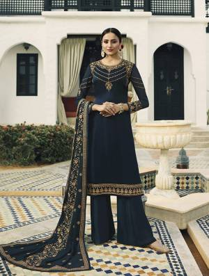 Enhance Your Personality Wearing This Designer Straight Suit In Navy Blue Color. This Heavy Embroidred Suit Is All Occasion Wear, Its Top Is Fabricated On Satin Georgette Paired With Santoon Bottom And Georgette Fabricated Heavy Embroidered Dupatta.