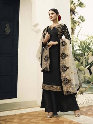 For A Bold And Beautiful Look, Grab This Designer Straight Cut Suit In Black Colored Top And Bottom Paired With Grey Colored Dupatta. Its Top Is Fabricated On Satin Georgette Paired With Santoon Bottom And Embroidered Net Fabricated Dupatta.
