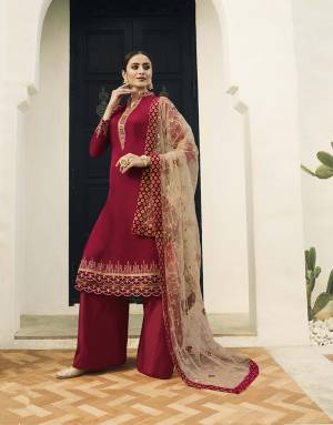 Adorn The Pretty Angelic Look Wearing This Designer Straight Cut Suit In Red Color Paired With Beige Colored Dupatta. Its Top Is Satin Georgette Based Paired With Santoon Bottom And Net Fabricated Dupatta. Its Top And Dupatta Are Beautified With Attractive Embroidery.