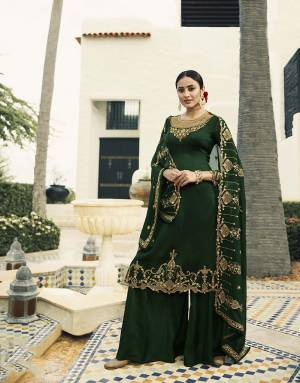 Enhance Your Personality Wearing This Designer Straight Suit In Dark Green Color. This Heavy Embroidred Suit Is All Occasion Wear, Its Top Is Fabricated On Satin Georgette Paired With Santoon Bottom And Georgette Fabricated Heavy Embroidered Dupatta.