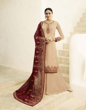 Celebrate This Festive Season With Ease And Comfort Wearing This Designer Straight Cut Suit In Beige Color Paired With Maroon Colored Dupatta. Its Top Is Fabricated On Satin Georgette Paired With Santoon Bottom And Georette Fabricated Dupatta. All Its Fabric Are Light Weight And Easy To Carry All Day Long.