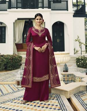 Bright And Visually Appealing Color Is Here With This Designer Straight Cut Suit In Magenta Pink Color Paired With Magenta Pink Colored Bottom And Dupatta. Its Pretty Embroidred Top And Dupatta Are Main Attracts Of This Lovely Suit.