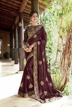 Look Beautiful Wearing This Designer Saree In Wine Color Paired With Wine Colored Blouse. This Saree Is Fabricated On Georgette Paired With Art Silk Fabricated Blouse. It Is Easy To Drape, Durable And Easy To Care Fo