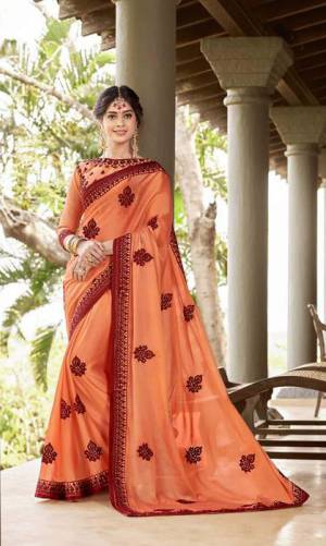 Shine Bright In This Designer Orange Colored Saree Paired?With Orange Colored Blouse. This Saree Is Georgette Based Paired With Art Silk Fabricated Blouse Beautified With Contrasting Thread Embroidery And Stone Work