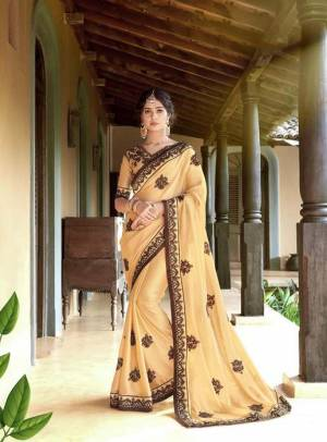 Rich And Elegant Looking Designer Saree Is Here In Beige Color Paired With Beige Colored Blouse. This Saree Is Georgette Based Paired With Art Silk Blouse, Beautified With Thread Embroidery And stone Work .It Is Light Weight And Easy To carry All Day Long.