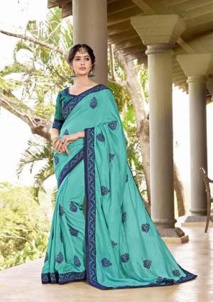 Celebrate This Festive Season Wearing This Designer Silk Based Saree In Turqoise Blue Color Paired With Turquoise Blue Colored Blouse. This Saree Is Georgette Based Beautified With Thread Embroidery And Stone Work?