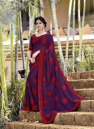 Rich And Elegant Looking Designer Saree Is Here In Purple Color Paired With Purple Colored Blouse. This Saree Is Georgette fabricated Beautified With Thread Embroidery And stone Work .It Is Light Weight And Easy To carry All Day Long.