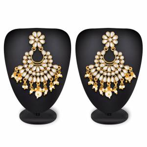 For Your Heavy Traditionals, Grab This Beautiful And Attractive Looking Earrings Set In Golden Color Beautified With Stone Work. This Can Also Be Paired With Any Colored Attire.