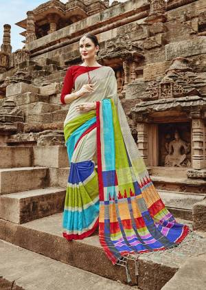 Go Colorful With This Designer Printed Saree In Mutli Color Paired With Red Colored Blouse. This Saree And Blouse are Fabricated On Khadi Silk Beautified With Prints.