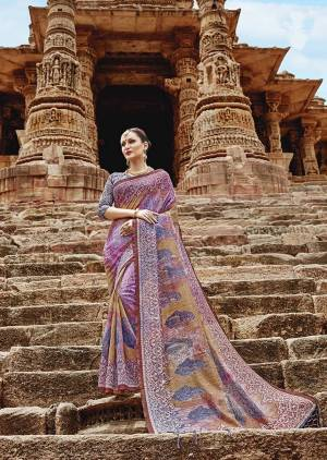 Go Colorful With This Designer Printed Saree In Mutli Color Paired With Multi Colored Blouse. This Saree And Blouse are Fabricated On Khadi Silk Beautified With Prints.