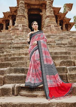 Grab This Beautiful Checkerd Saree In Red And Grey Color Paired With Black Colored Blouse. This Saree And Blouse Are Fabricated On Khadi Silk Beautified With Checks Prints All Over It.