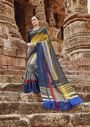 Enhance Your Personality In This Rich Looking Designer Saree With Bold Color Pallete. This Saree Is In Yellow And Grey Paired With Dark Blue Colored Blouse. It Is Fabricated On Khadi Silk Which Is Easy To Carry All Day Long.