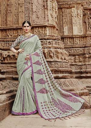This Season Is About Subtle Shades And Pastel Play, So Grab This Designer Saree In Pastel Green Color Paired With Pastel Green Colored Blouse. This Satee And Blouse Are Fabricated On Khadi Silk Beautified With Prints.