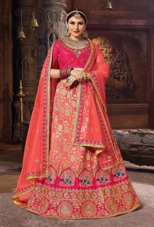 Catch All The Limelight Wearing This Heavy Designer Lehenga Choli In Dark Pink Colored Blouse Paired With Dark Peach Lehenga And Dupatta. Its Blouse Is Fabricated On Art Silk Paired With Banarasi Art Silk Lehenga And Net Fabricated Dupatta. Its Attractive Color And Rich Fabric Will Give An Amazing Look.