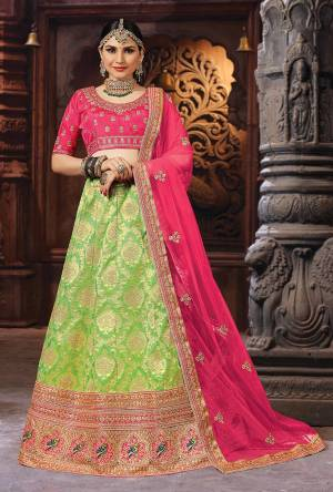 Bright And Appealing Color Is Here With This Designer Lehenga Choli In Fuschia Pink Colored Blouse And Dupatta Paired With Green Colored Lehenga. This Silk Based Lehenga Choli IS Paired With Net Fabricated Dupatta. Buy Now.