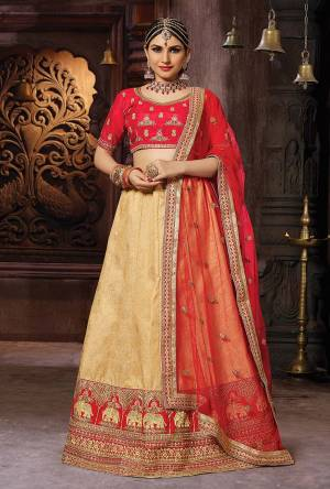 Evergreen Combination Is Here With This Designer Lehenga Choli In Red And Beige Color. This Lehenga Choli Is Silk Based Paired With Net Fabricated Dupatta. Buy This Designer Piece Now.