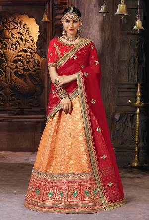 For A Proper Traditional Look, Grab This Designer Lehenga Choli In Red And Orange Color. Its Blouse Is Fabricated On Art Silk Paired With Banarasi Art Silk Lehenga And Net Fabricated Dupatta.