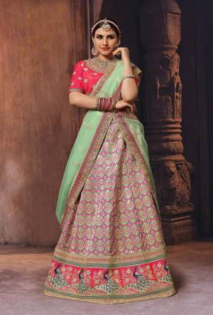 Bright And Appealing Color Is Here With This Designer Lehenga Choli In Fuschia Pink Colored Blouse Paired With Multi Colored Lehenga And Light Green Colored Dupatta.  This Silk Based Lehenga Choli IS Paired With Net Fabricated Dupatta. Buy Now.