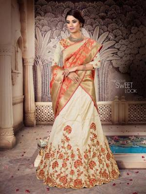 Here Is a Proper Indian Traditional Look With This Beautiful Designer Lehenga Choli. This Designer Lehenga Choli IS Silk Based Paired With Jacquard Silk Fabricated Dupatta And It Has Another Dupatta Fabricated On Net. It Is Beautified With Contrasting Heavy Embroidery Over Blouse And Lehenga Giving It A More Attractive Look.