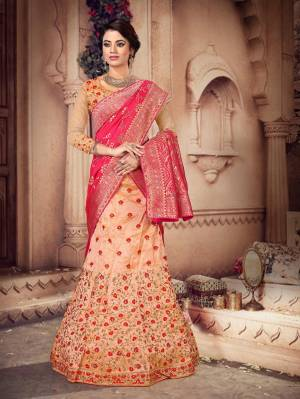 You Will Definitely Earn Lots Of Compliments Wearing This Heavy Designer Lehenga Which Has Two Dupatta Concept. This Heavy Embroidered Lehenga Choli Is Silk Based Paired With One Jacquard Silk Dupatta And Another Net Fabricated Dupatta. All Its Fabrics And Color Pallete Will Also Give A Rich Look To Your Personality.