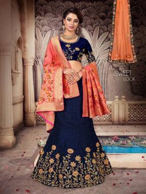 Grab This Heavy Designer Lehenga Choli For The Upcoming Festive And Wedding Season Which Comes With Two Dupattas. This Pretty Lehenga Choli IS Fabricated On Art Silk Paired With A Jacquard Silk Dupatta And Another Net Fabricated dupatta.