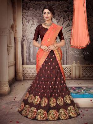 For A Pretty Festive Look, Grab This Heavy Embroidered Designer Lehenga Choli With Two Dupatta. This Lehenga Choli Is Silk Based Paired With A Very Pretty Jacquard Silk Dupatta And Another Net Fabricated Dupatta. Its Blouse And Lehenga Are Beautified With Contrasting Thread & Jari Embroidery. Buy Now.