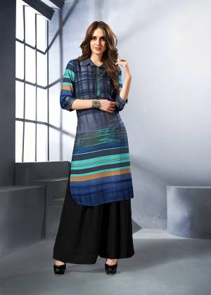 Grab This Readymade Kurti In Shades Of Blue. This Pretty Kurti Is Fabricated On Rayon Beautified With Prints All Over. Buy This Now.