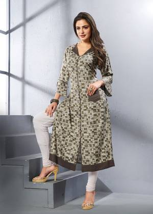 Here Is Checks Printed Readymade Kurti In Grey And Brown Color Fabricated On Rayon. It Is Beautified With Small Checks All Over It.