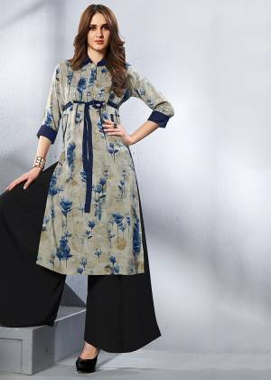 This Formal Looking Kurti Is Perfect For Your Office Wear In Grey Color. It Is Fabricated On Rayon And Can Be Paired With Leegings, Pants Or Plaazo.