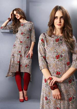Go Colorful With This Pretty Kurti In Multi Color Fabricated On Rayon. Its Pretty Attractive Colors Are Perfect For Summers. Buy Now.