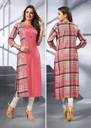 Add This Pretty Designer Readymade Kurti To Your Wardrobe In Dark Peach Color. This Kurti Is Fabricated On Rayon Beautified With Checks Prints. Buy Now.