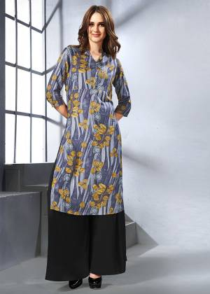 Unique Print Pattern Is Here With This Readymade Kurti In Dark Grey Color Fabricated On Rayon. It Is Beautified With Abstract And Floral Prints. Buy Now.