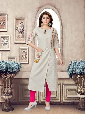 Here Is An Amazing Designer Patternred Readymade Kurti In Cream Color. This Pretty Kurti Is Cotton Based Beautified With Multi Colored Thread Work. Buy Now.