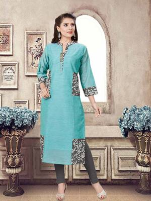 For Your Office Wear, this Formal Kurti Is Perfectly Suitable. This Readymade Kurti Is In Turquoise Blue which IS Chanderi Fabricated Beautified With Prints.
