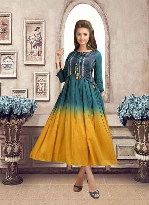 New And Unique Look Is Available Here With This Designer Readymade Kurti In Prussian Blue And Yellow Color. This Kurti Is Fabricated On Linen Which Is Light Weight And Easy To Carry All Day Long.