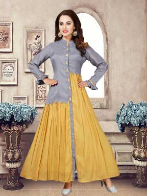 Adorn A Pretty New and Unique Look With This Readymade Designer Kurti In Grey And Yellow Color Fabricated On Muslin. It Is Light Weight, Durable And Easy To Care For.
