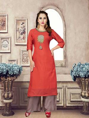 Grab This Designer Readymade Kurta Set In Red Colored Top Paired With Grey Colored Bottom. Both The Top And Bottom Are Fabricated On Mulsin Which Are Soft Towards Skin And Easy To Carry All Day Long.