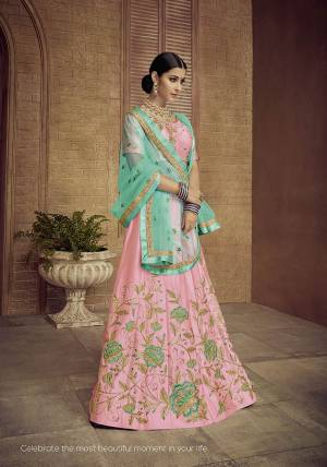 Look Pretty In This Designer Pink Colored Lehenga Choli Paired With Contrasting Turquoise Blue Colored Dupatta. It Is Satin Silk Based Beautified With Attractive Embroidery Paired With Net Fabricated Dupatta.